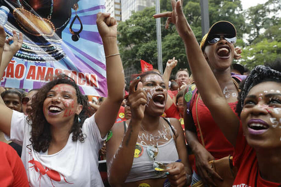 Demonstrators shout anti-government slogans as they demand the impeachment of Brazil's President Michel Temer in Sao Paulo, Brazil, Sunday, Nov. 27, 2016. Protesters expressed outrage at a host of Temer's policies, including the government's proposal to cap spending to rein in the deficit. (AP Photo/Andre Penner) Photo: Andre Penner