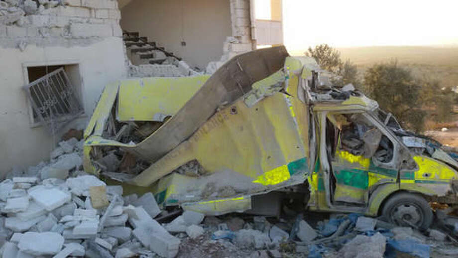 This photo provided by the Shafak Charity Organization, which has been authenticated based on its contents and other AP reporting, shows an ambulance destroyed following four consecutive airstrikes on a medical facility dedicated to women in the northern Idlib province, Syria, Friday, Nov. 25, 2016. The airstrikes knocked the facility out of service and killed two civilians. Shelling in the northern city of Aleppo also knocked out another gynecology hospital Friday, badly damaging it. (Shafak Charity Organization via AP) Photo: Uncredited