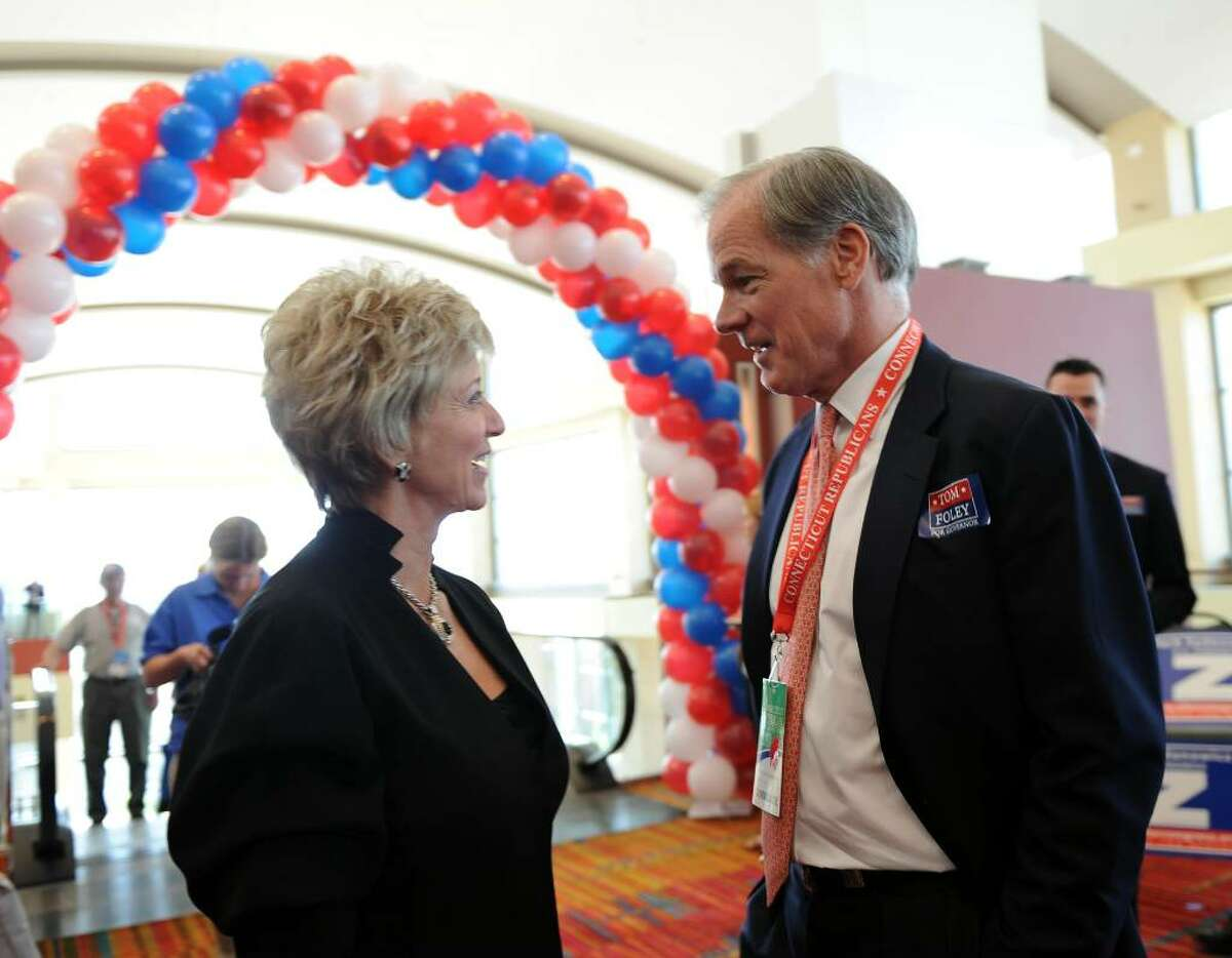 Candidate for US Senate Linda McMahon, left, chats with Connecticut candidate for governor Tom Foley, before the start of the GOP convention in downtown Hartford, Conn. on Friday May 21, 2010.