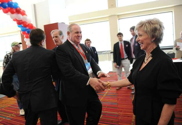 Candidate for US Senate Linda McMahon, right, chats with Dave Theis, a delegate from Greenwich, before the start of the GOP convention in downtown Hartford, Conn. on Friday May 21, 2010. Photo: Christian Abraham / Connecticut Post