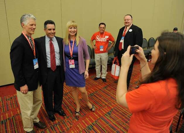 Sam Caligiuri poses for a photo with supporters after being nominated to run against Democrat Rep. Chris Murphy in the 5th Congressional District during the GOP convention in downtown Hartford, Conn. on Friday May 21, 2010. At left is supporter John Sullivan, of Harwington, with Caligiuri and John's wife Teresa. Taking the photo is Caligiuri's Communication Director Tiffany Romero Grossman. Photo: Christian Abraham / Connecticut Post