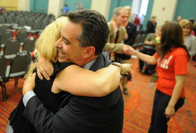 Sam Caligiuri gets a hug from State Rep. Debralee Hovey (112th Dist. Monroe and Newtown) after Caligiuri was nominated to run against Democrat Rep. Chris Murphy in the 5th Congressional District during the GOP convention in downtown Hartford, Conn. on Friday May 21, 2010. Photo: Christian Abraham / Connecticut Post