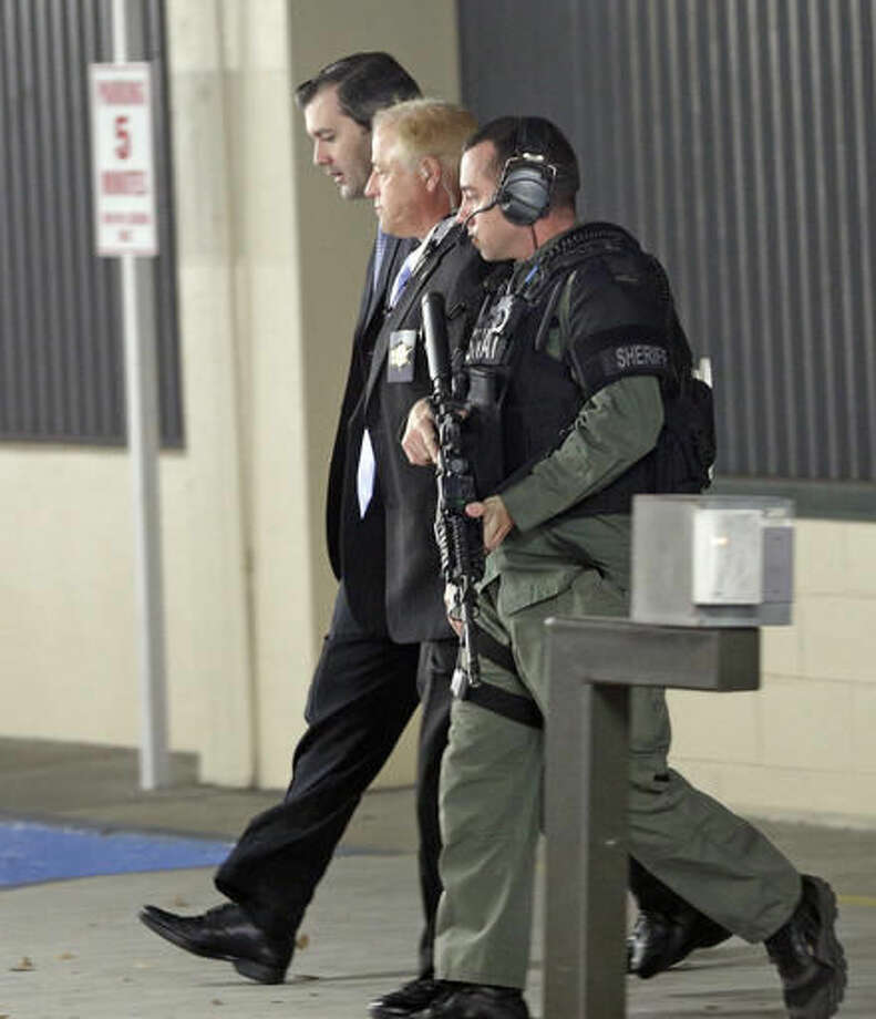 Former North Charleston police officer Michael Slager, far left, is escorted from the courthouse during his murder trial at the Charleston County court in Charleston, S.C., Friday, Dec. 2, 2016. The case of a former South Carolina police officer charged with murder in the shooting death of an unarmed black motorist is now before the jury. (AP Photo/Chuck Burton) Photo: Chuck Burton