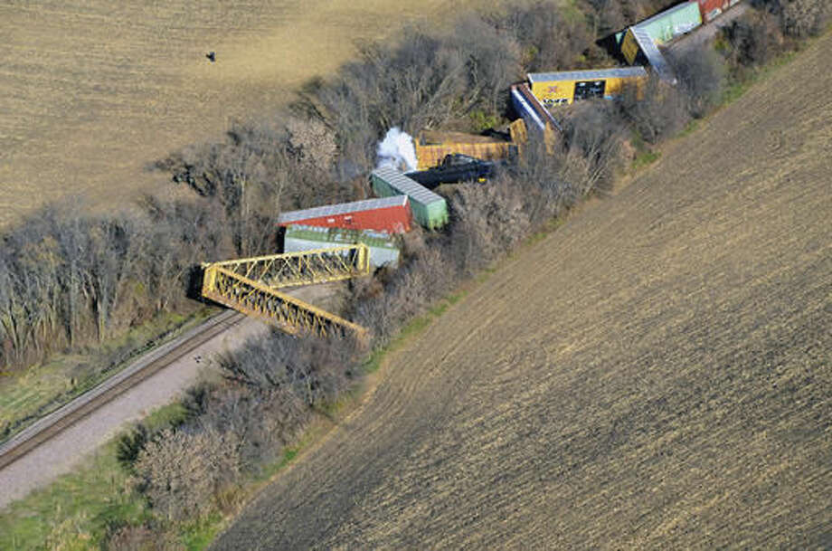 Several cars from a Union Pacific train are seen derailed near Ellendale, Minn., Friday morning, Nov. 11, 2016. The derailment and hazardous chemical spill prompted evacuations in the small southern Minnesota town and the closure of a state highway. No injuries were reported. (Ryan Anderson/The People's Press via AP) Photo: Ryan Anderson
