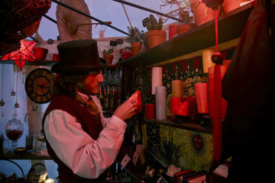 In a Saturday, Nov. 19, 2016 photo, Benjamin Lee-Roche lights candles in a tent with magical artifacts at his home in Springville. Roche has been building an academy of witchcraft and wizardry, based loosely off of the famed Harry Potter series, for kids to come and enjoy and learn, for fun, about different aspects of the whimsical.(Dominic Valente/Daily Herald via AP) Photo: Dominic Valente