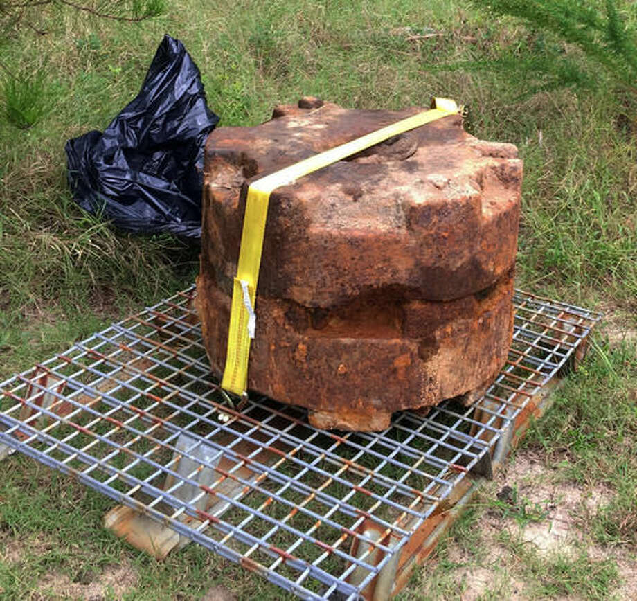 Two mine weights from WWII were recently discovered in a pathway to the beach at Cape Henlopen State Park. The weights were exposed during Hurricane Hermine, and are relics from Cape Henlopen's role as Fort Miles, part of the Army's coastal defense network during WWII. (Molly Murray/The News Journal via AP) Photo: Molly Murray