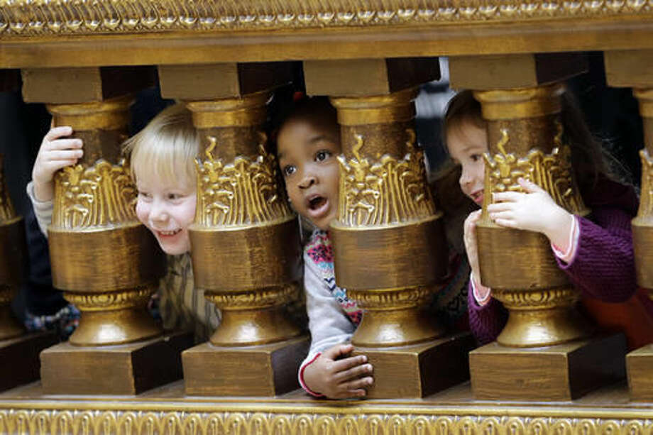 In this Nov. 22, 2016 photo, children peer through a railing during an event to thank lawmakers for funding a five-county pre-K pilot program during Organization Day at the Statehouse in Indianapolis. Indiana legislative leaders are advocating a go-slow approach to expanding the state-funded preschool program and warning there might be little money to boost school spending in the next state budget. (AP Photo/AJ Mast) Photo: AJ Mast