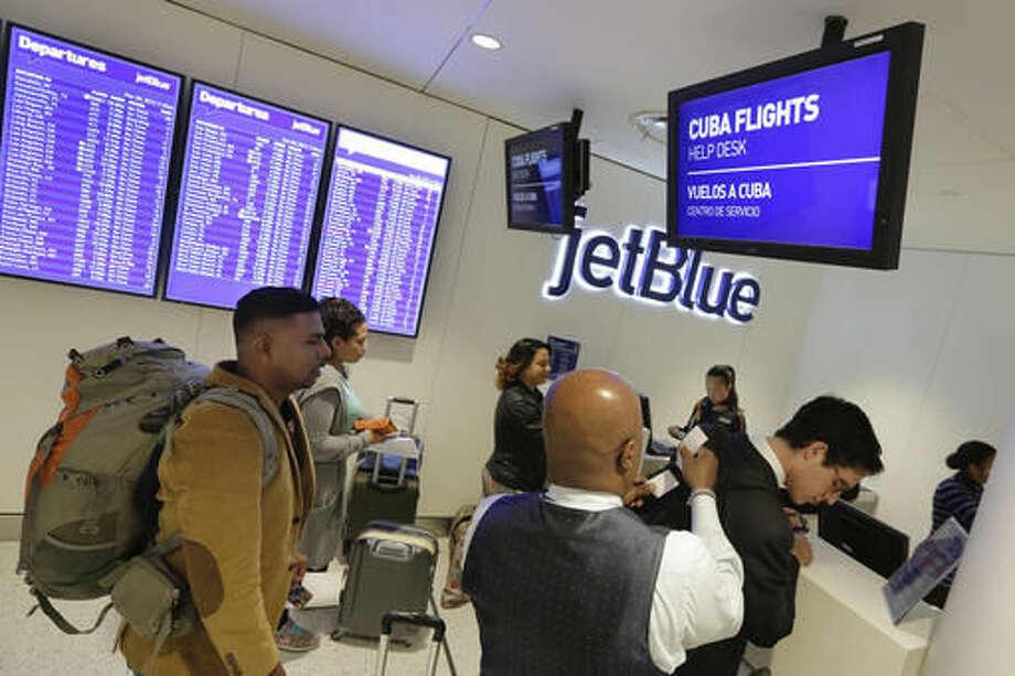 Passengers check in for JetBlue's inaugural flight from New York to Havana at New York's John F. Kennedy International Airport, Monday, Nov. 28, 2016. (AP Photo/Richard Drew) Photo: Richard Drew