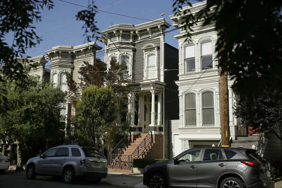 "FILE - This May 27, 2016, file photo, shows a Victorian home, center, in San Francisco, made famous by the television show ""Full House."" The home was sold to producer Jeff Franklin, who created the show. The veteran TV producer bought the 3-bedroom Victorian, which was on the market for over $4 million, in August. The realtor had declined to say at the time who bought the home, which is in San Francisco's Lower Pacific Heights neighborhood. The home's exterior was used as the Tanner family's residence in the original show. (AP Photo/Eric Risberg,File) Photo: Eric Risberg"