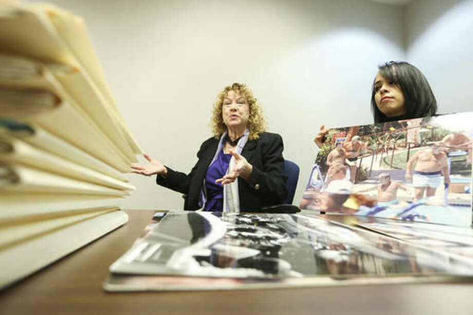 In this Nov. 22, 2016, photo, Lynn Goya, Clark County Clerk, left, and senior office specialist Rocio Leon show of some of the records that are being digitized at the Clark County Government Center in Las Vegas. Everything from government documents from the 1800s to photos from investigations are being indexed so they can be easily searchable. (Brett Le Blanc/Las Vegas Review-Journal via AP) Photo: Brett Le Blanc