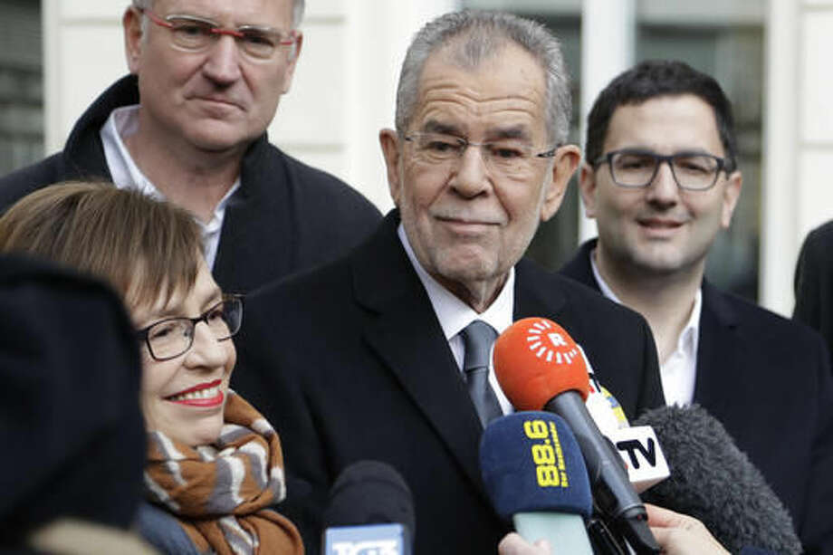 Alexander Van der Bellen, candidate of the Austrian Greens, briefs the media besides his wife Doris Schmidauer after leaving a polling station and casting their votes in Vienna, Austria, Sunday, Dec. 4, 2016. Austria holds presidential elections in a contest pitting a left-leaning contender against a right-winger supported by a populist anti-immigration party. (AP Photo/Matthias Schrader) Photo: Matthias Schrader