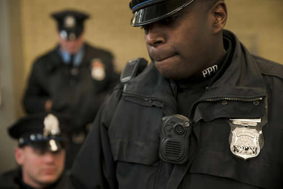 FILE - In this Dec. 11, 2014, file photo, Philadelphia police officers demonstrate a body-worn camera used as part of a pilot project in Philadelphia. Government offices across Pennsylvania didn't apply the state's Right-to-Know Law uniformly, according to a May 2016 survey by 21 newspapers. Dash-cam videos have fueled a national debate on police policies and tactics, but in Pennsylvania those images remain largely out of sight, thanks to state laws that give law enforcement broad power to keep out of public view anything considered to be investigative material. (AP Photo/Matt Rourke, File) Photo: Matt Rourke