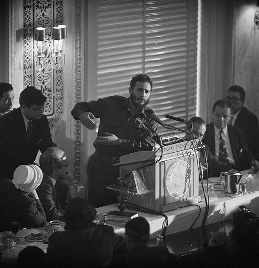 FILE - In this April 20, 1959 file photo, Cuba's leader Fidel Castro addresses a National Press Club luncheon in Washington, D.C. Former President Fidel Castro, who led a rebel army to improbable victory in Cuba, embraced Soviet-style communism and defied the power of 10 U.S. presidents during his half century rule, has died at age 90. The bearded revolutionary, who survived a crippling U.S. trade embargo as well as dozens, possibly hundreds, of assassination plots, died eight years after ill health forced him to formally hand power over to his younger brother Raul, who announced his death late Friday, Nov. 25, 2016, on state television. (AP Photo/John Rous, File) Photo: John Rous