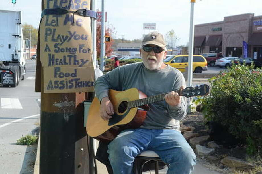 ADVANCE FOR WEEKEND EDITIONS, NOV. 26-27 - In this Nov. 15, 2016 photo, Navy veteran Kevin Morgan plays guitar on the side of a busy street in Clarksville, Tenn., to support himself. (Pranaav Jadhav/The Leaf-Chronicle via AP) Photo: Pranaav Jadhav
