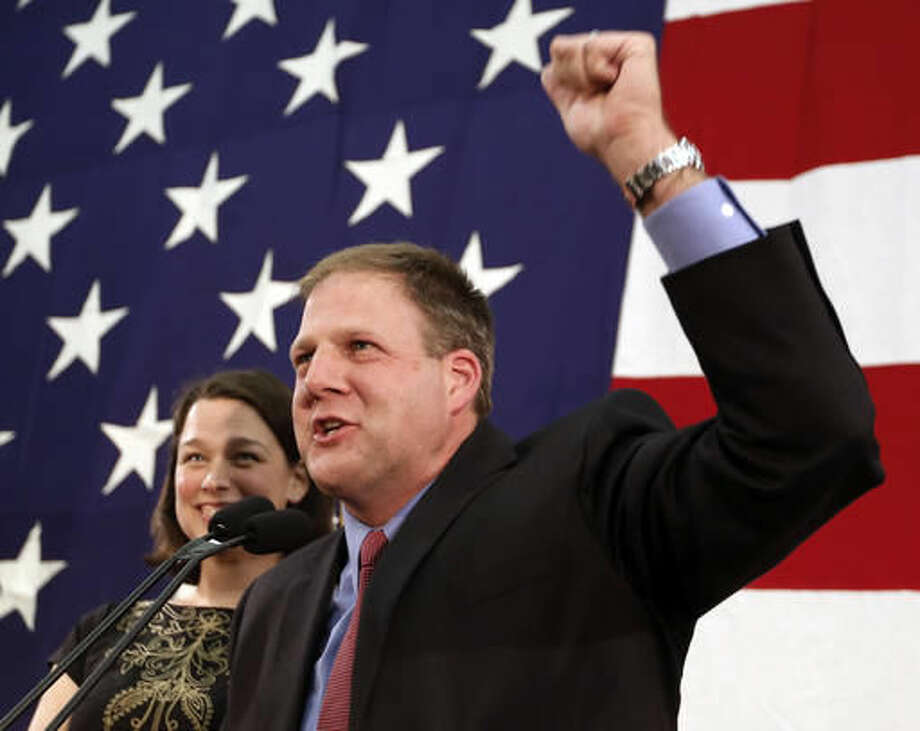 With his wife Valerie at his side Republican candidate for governor Chris Sununu speaks to supporters early in the morning Wednesday, Nov. 9, 2016, in Concord, N.H. Sununu said his race with Democratic challenger Colin VanOstern was too close to call. (AP Photo/Jim Cole) Photo: Jim Cole