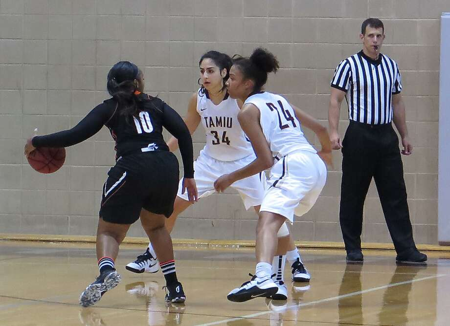 TAMIU's Nayiri Aslanian, center, stepped in for the injured Rosebrooke Hunt, right, and scored a team-high 15 points on Monday in a 69-41 loss at Central Oklahoma. The Dustdevils dropped to 0-8 for the first time and finished with the second-fewest points in a game in program history against the Bronchos. Photo: Cuate Santos /Laredo Morning Times