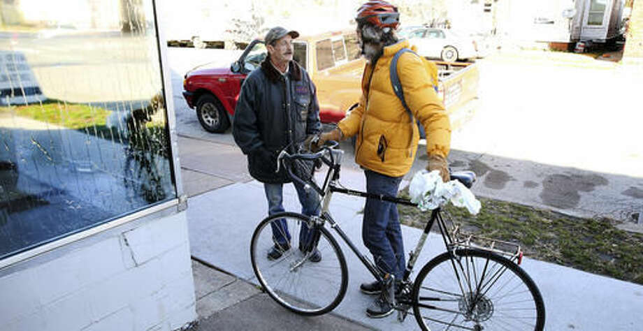 ADVANCE FOR SUNDAY, NOV. 20, 2016 - In this Thursday, Nov. 10, 2016 photo, Chris Dunn, right talks with Rick Powers a Vietnam Veteran outside Timothy's House of Hope to check on homeless veterans in Davenport, Iowa. (Kevin E. Schmidt/Quad City Times via AP) Photo: Kevin E. Schmidt