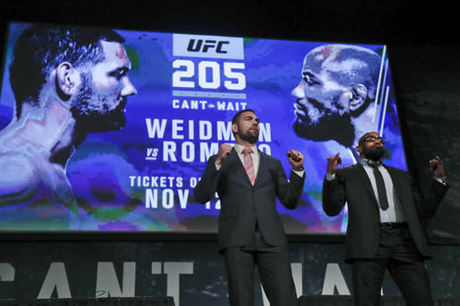 """FILE- In this Sept. 27, 2016 file photo, UFC middleweight fighters Chris Weidman, left, and Yoel Romero pose for photos during a news conference for UFC 205 in New York. Weidman and Romero are on the first major UFC card to be held in New York after the state legislature legalized the sport earlier in 2016. """"This is a dream come true,"""" says middleweight Chris Weidman, a native New Yorker, who will be part of the undercard for the Saturday, Nov 12, 2016, pay-per-view event that features a lightweight title bout between Conor McGregor and Eddie Alvarez. (AP Photo/Julie Jacobson, File) Photo: Julie Jacobson"""
