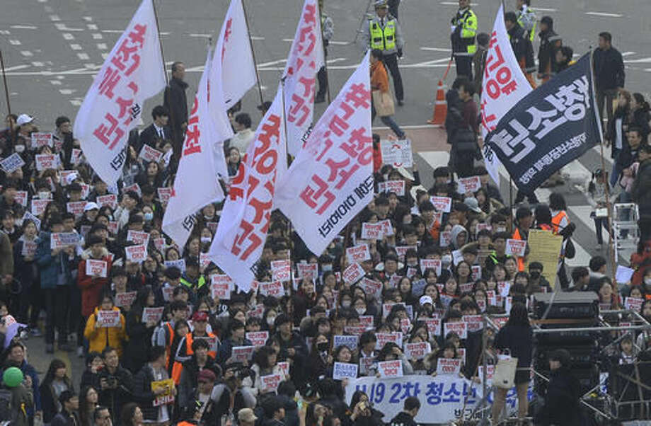 South Koreans gather to demand President Park Geun-Hye to step down, Saturday, Nov. 19, 2016, Seoul, South Korea. For the fourth straight weekend, masses of South Koreans were expected to descend on major avenues in downtown Seoul demanding an end to the presidency of Park, who prosecutors plan to question soon over an explosive political scandal. (Kim Min-Hee/Pool Photo via AP) Photo: Kim Min-Hee