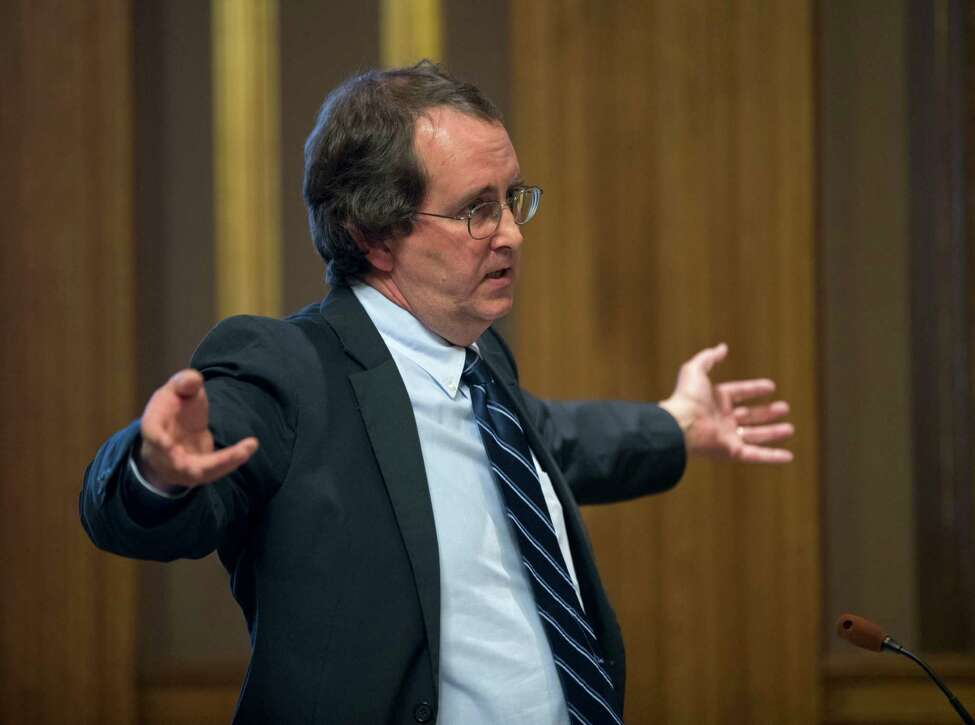Attorney John Caffry, representing the environmental group Protect the Adirondacks, argues in state Supreme Court on Monday, Dec. 5, 2016, in Albany, N.Y. A state court will decide whether new snowmobile trails being carved through the Adirondack forest violate the