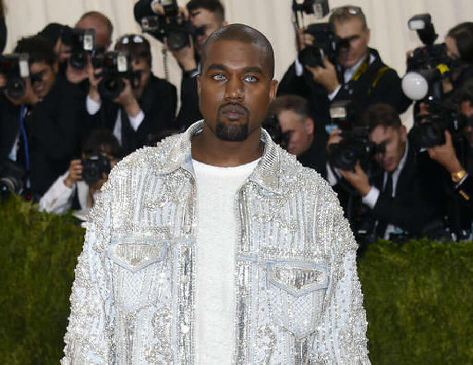"""FILE - In this May 2, 2016 file photo, Kanye West arrives at The Metropolitan Museum of Art Costume Institute Benefit Gala, celebrating the opening of """"Manus x Machina: Fashion in an Age of Technology"""" in New York. West was taken to Ronald Reagan UCLA Medical Center in Los Angeles on Monday, Nov. 21, for stress and exhaustion. (Photo by Evan Agostini/Invision/AP) Photo: Evan Agostini"""