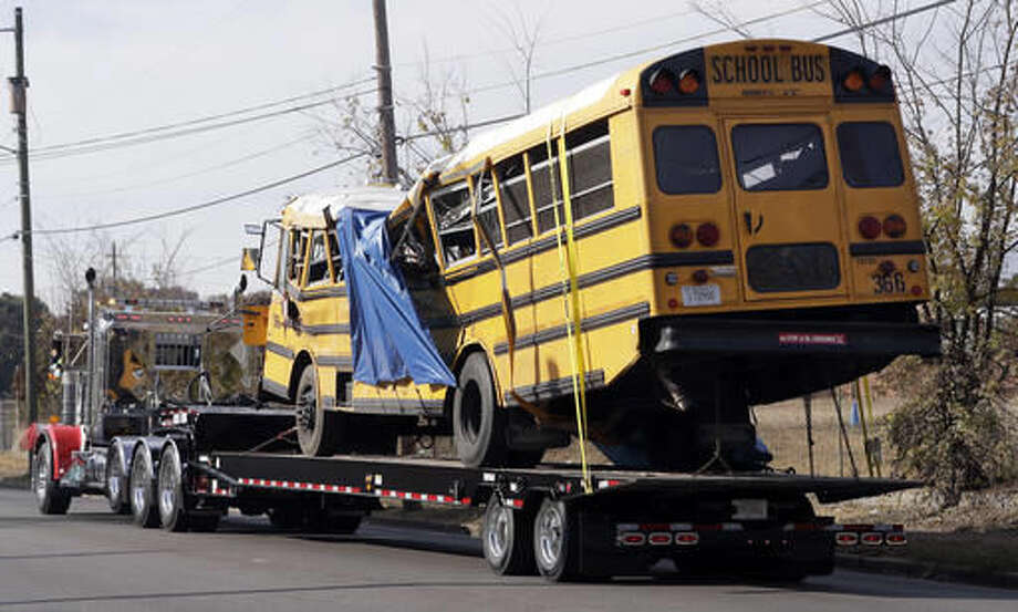 FILE- In this Nov. 22, 2016, file photo, a school bus is carried away in Chattanooga, Tenn., from the site where it crashed. Students and administrators raised concerns about a Tennessee school bus driver's behavior behind the wheel in the weeks before a crash that killed several children. Records released by the school district Friday, Nov. 25, include two written statements by students complaining about Johnthony Walker's driving. (AP Photo/Mark Humphrey, File) Photo: Mark Humphrey