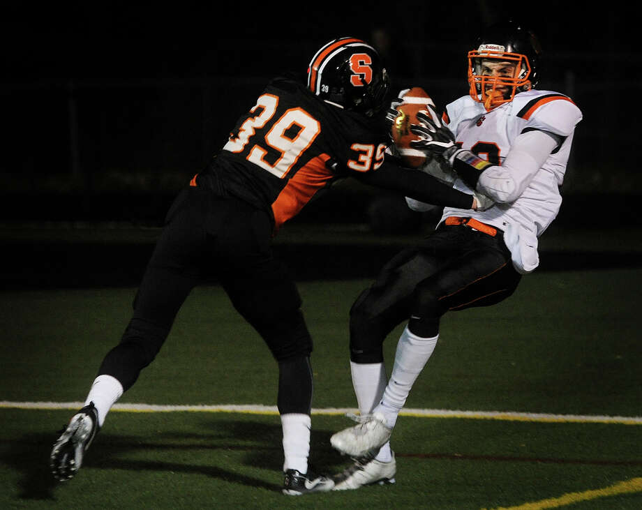 Ridgefield's Christopher Longo, right, catches a touchdown ahead of Shelton defender David D'Amore during the first half of the Class LL football semifinals at Shelton High School in Shelton, Conn. on Monday, December 5, 2016. Photo: Brian A. Pounds, Hearst Connecticut Media / Connecticut Post
