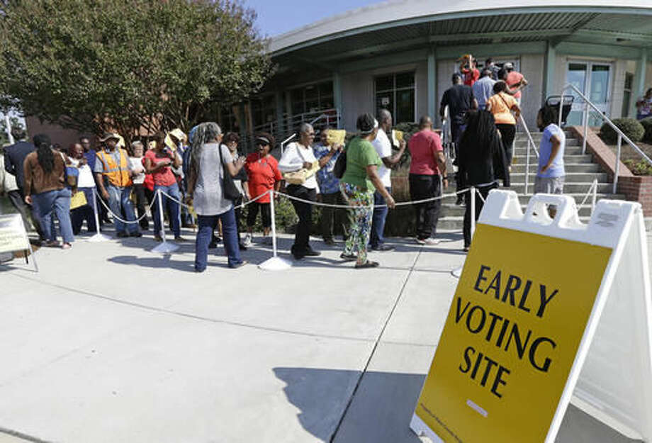 FILE - In this Oct. 20, 2016 file photo ,voters line up during early voting at Chavis Community Center in Raleigh, N.C. More than a dozen states have enacted tougher requirements for registering and voting since the U.S. Supreme Court overturned a key provision of the Voting Rights Act three years ago. That has led to confusion and claims that certain groups, mostly minorities who tend to vote with Democrats, are being disenfranchised. (AP Photo/Gerry Broome, File) Photo: Gerry Broome
