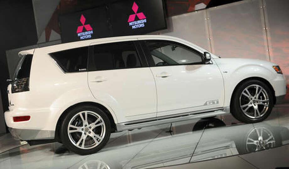 FILE - In an April 9, 2009 file photo, the Mitsubishi Outlander GT is introduced at the 2009 New York International Auto Show. Mitsubishi is recalling two SUV models to fix problems that could cause the windshield wipers to malfunction. The first recall covers about 100,000 Outlanders from the 2007 to 2013 model years. Mitsubishi says water can get between the hood and windshield and cause a ball joint to rust. That can knock out the wipers. Dealers will replace a rubber boot on the joint to keep water out.(AP Photo/Richard Drew, File) Photo: Richard Drew