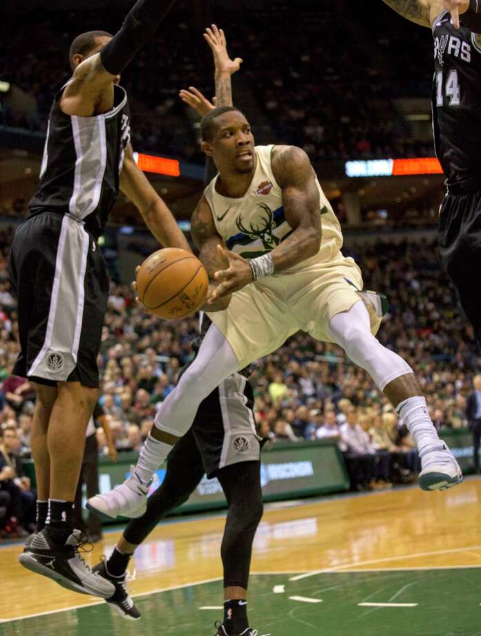 Milwaukee Bucks guard Eric Bledsoe, center, is defended by the San Antonio Spurs during the first half of an NBA basketball game Sunday, March 25, 2018, in Milwaukee. (AP Photo/Darren Hauck) Photo: Darren Hauck, Associated Press / darren hauck