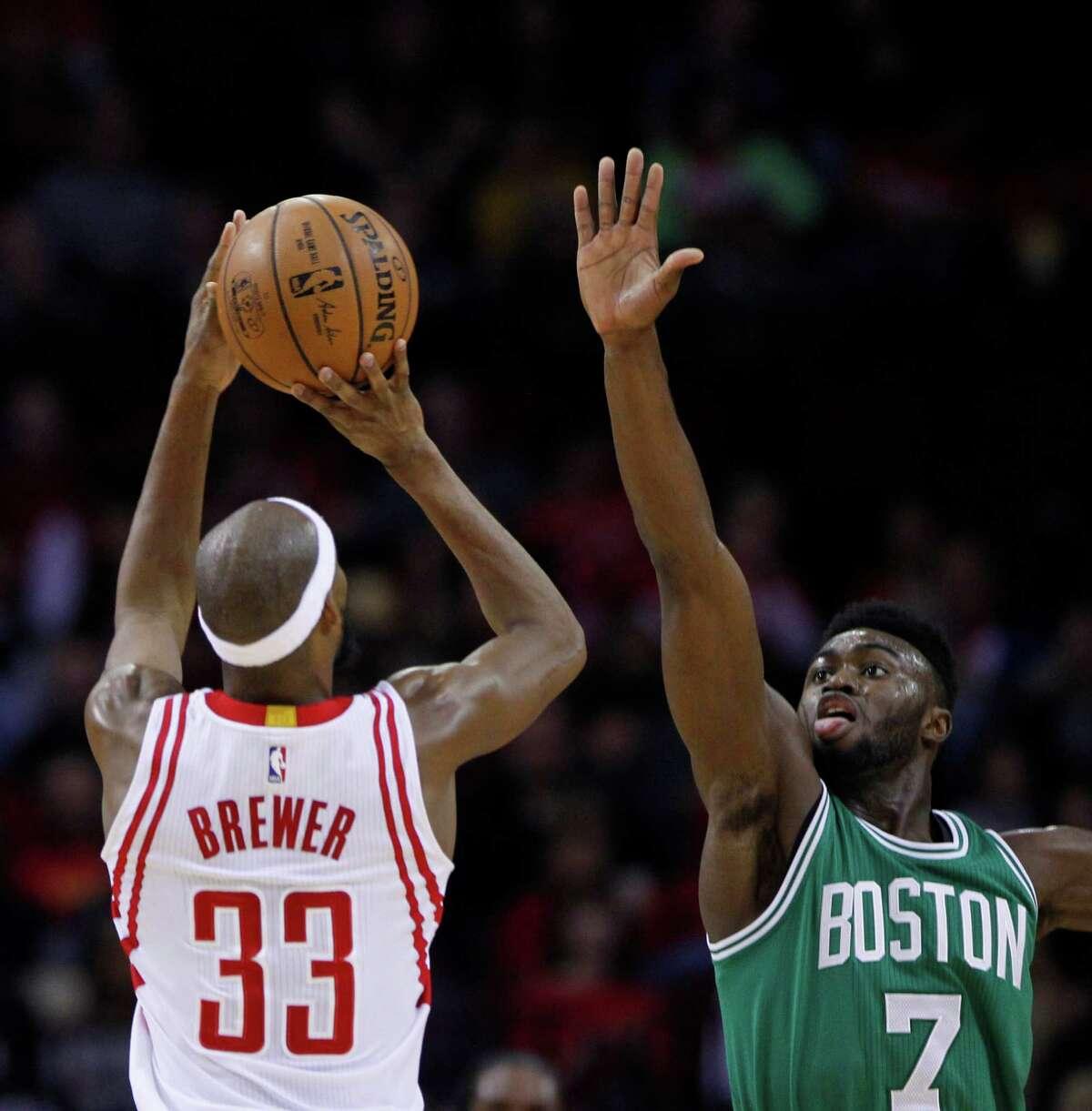 Houston Rockets forward Corey Brewer (33) shoots over Boston Celtics forward Jaylen Brown (7) during the Rockets game against the Boston Celtics at Toyota Center, Monday, Dec. 5, 2016, in Houston.