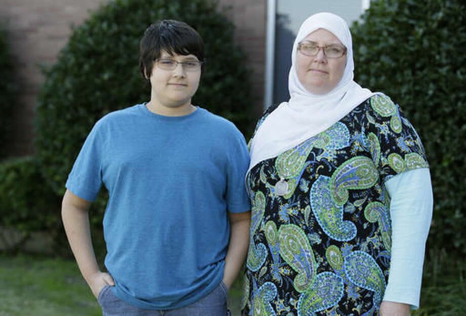 In this Thursday, Nov. 10, 2016 photo, seventh-grader Habib Rahman, 12, left, poses for a photo with his mother, Melissa Walker, in front of his middle school in Rockwall, Texas. Children are processing the outcome of a presidential run that was often not kid-friendly. Rahman said he would've liked to see Bernie Sanders go farther in the race for the White House. (AP Photo/LM Otero) Photo: LM Otero