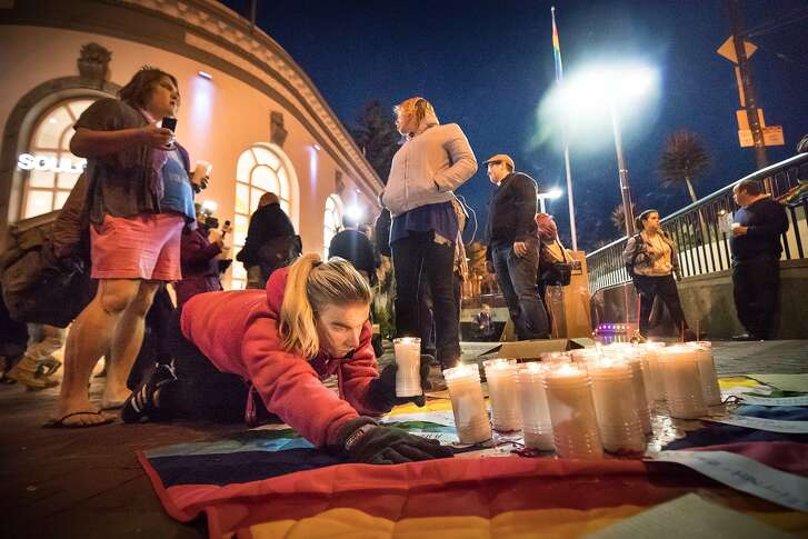 Cotton Kandy Sandie pray at the vigil for the December 2, 206 Oakland warehouse fire that killed at least 36 people in the San Francisco, CA. Castro District on Monday, December 5, 2016, Castro St. and Market.