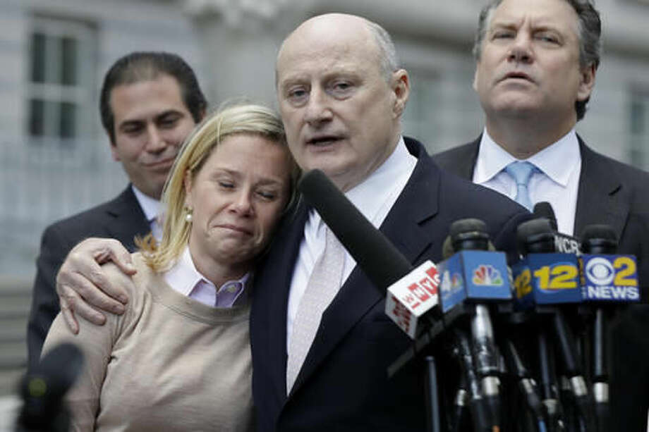 Bridget Anne Kelly, left, former Deputy Chief of Staff for New Jersey Gov. Chris Christie, is held by her lawyer Michael Critchley while talking to reporters after she was found guilty on all counts in the George Washington Bridge traffic trial at Martin Luther King, Jr., Federal Court, Friday, Nov. 4, 2016, in Newark, N.J. (AP Photo/Julio Cortez) Photo: Julio Cortez