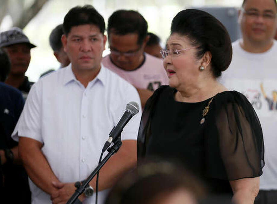 """Imelda Marcos, widow of the late Philippine dictator Ferdinand Marcos, addresses hundreds of supporters following a mass at his graveyard Saturday, Nov. 19, 2016, a day after Marcos was buried in a secrecy-shrouded ceremony at the Heroes' Cemetery in suburban Taguig city, east of Manila, Philippines. Long-dead Marcos was buried Friday at the country's Heroes' Cemetery in a secrecy-shrouded ceremony, a move approved by President Rodrigo Duterte that infuriated supporters of the """"people power"""" revolt that ousted Marcos three decades ago. (AP Photo/Bullit Marquez) Photo: Bullit Marquez"""