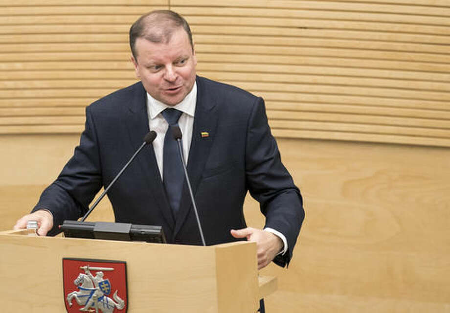 Lithuania's Peasant and Green's Union (LPGU) party leader Salius Skvernelis speaks in parliament in Vilnius, Lithuania, Tuesday, Nov. 22, 2016. Lithuania's parliament approved Skvernelis as the new prime minister on Tuesday. (AP Photo/Mindaugas Kulbis) Photo: Mindaugas Kulbis