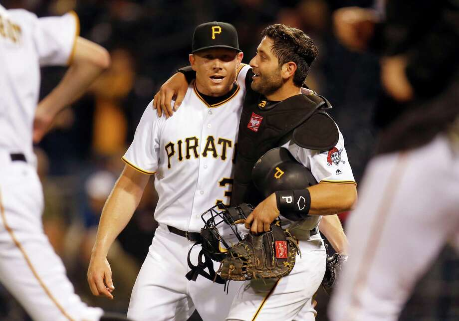 PITTSBURGH, PA - MAY 17:  Francisco Cervelli #29 of the Pittsburgh Pirates hugs Mark Melancon #35 after defeating the Atlanta Braves 12-9 at PNC Park on May 17, 2016 in Pittsburgh, Pennsylvania.  (Photo by Justin K. Aller/Getty Images) ORG XMIT: 607677701 Photo: Justin K. Aller / 2016 Getty Images
