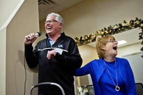 Helping Hands Dental Center Board Past President Greg Dorrien, left, and current President Dr. Kay Gable, DDS, share a laugh during an open house on Monday at Helping Hands Dental Center. The event was held to give people the opportunity to see the finished expansion of the facility. The $700,000 project was made possible with funds from the Charles J. Strosacker Foundation with a donation of $350,000, the Rollin M. Gerstacker Foundation with a donation of $150,000 and The Herbert H. and Grace A. Dow Foundation with a donation of $75,000. The Midland Area Community Foundation and the Delta Dental Foundation also contributed money to the cause. The center operates in partnership with the Midland County Health Department and is the only Medicaid dental provider in Midland County. The expansion, which was finished in October, has helped staff see more patients, lower wait times and better accommodate disabled clients.