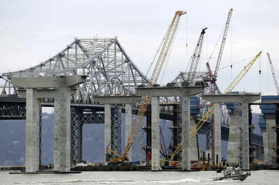 FILE- In this Jan. 14, 2016 file photo, construction continues on the new Tappan Zee Bridge as it is seen from Tarrytown, N.Y. New York Gov. Andrew Cuomo has launched efforts to rebuild Kennedy and LaGuardia airports, remodel and expand Penn Station, and replace the Tappan Zee Bridge. Federal support could be critical to getting the work done, and Cuomo, a Democrat, says he hopes Republican president-elect Donald Trump understands the need to help. (AP Photo/Seth Wenig, File) Photo: Seth Wenig