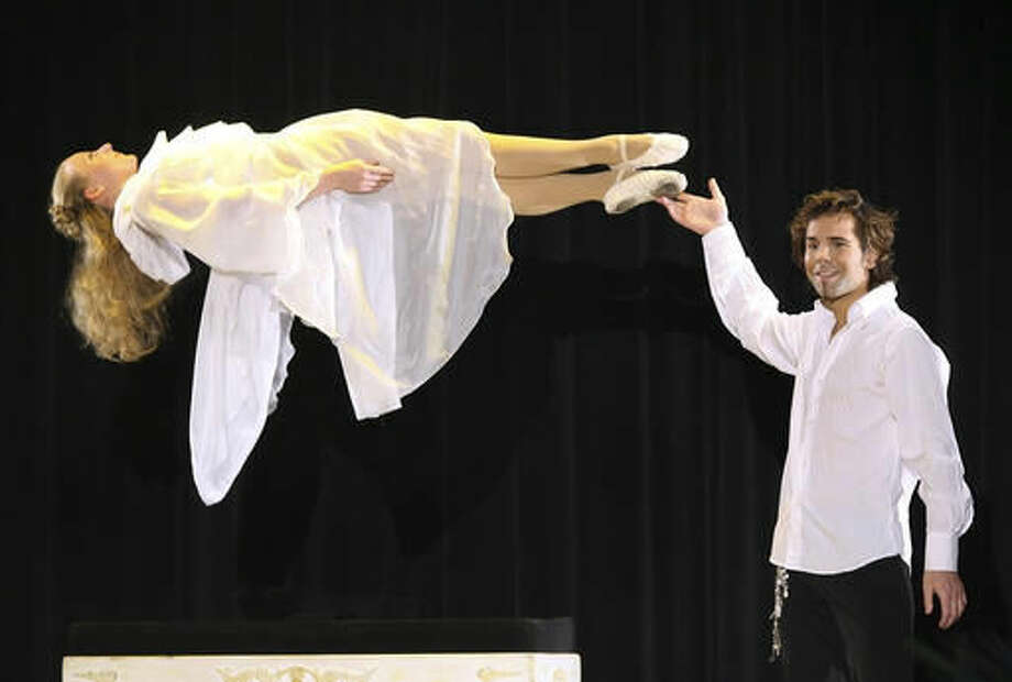 FILE - This March 17, 2007, file photo, magician Jan Rouven presents the Floating Virgin during the dress rehearsal of a German TV show in Riesa, eastern Germany. A judge is due to begin hearing evidence Monday, Nov. 14, 2016, against Rouven, who faces the possibility of decades in prison and up to $1 million in fines on federal child pornography charges. (AP Photo/Eckehard Schulz, File) Photo: Eckehard Schulz