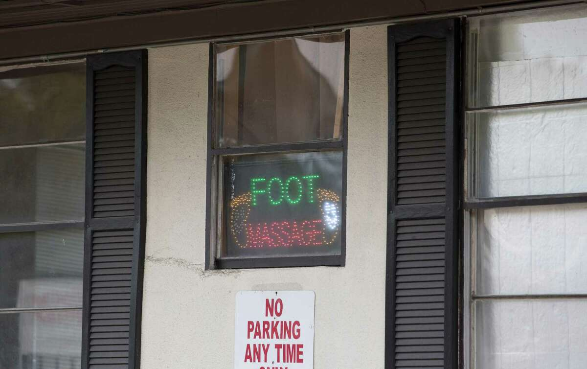 Signs at a massage parlor on Richmond remained lit last month even after the establishment was sued by Harris County on accusations of being a front for prostitution.