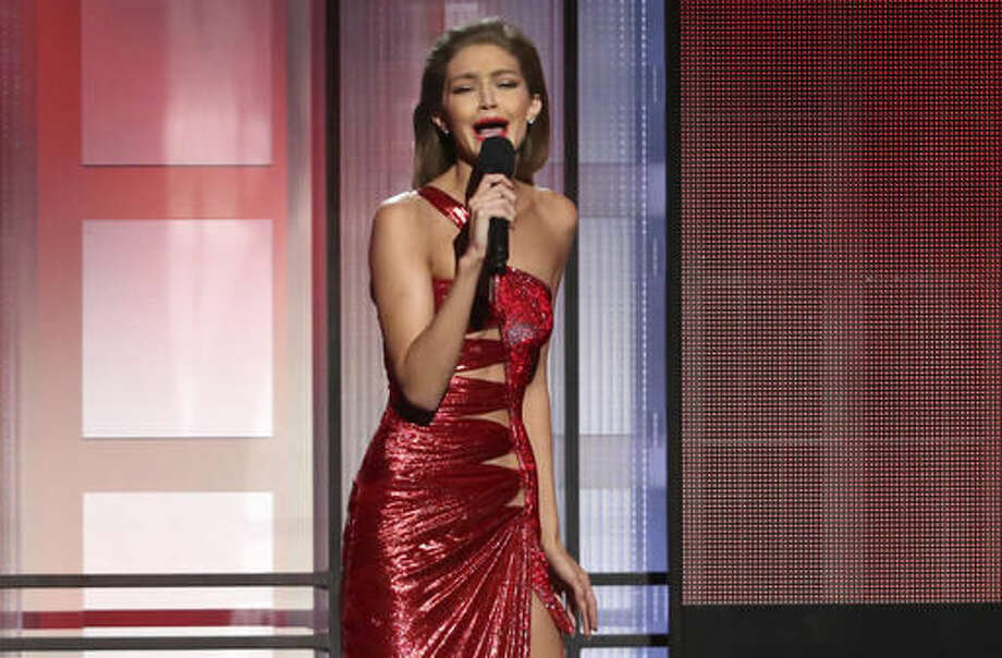 Host Gigi Hadid impersonates Melania Trump at the American Music Awards at the Microsoft Theater on Sunday, Nov. 20, 2016, in Los Angeles. (Photo by Matt Sayles/Invision/AP) Photo: Matt Sayles