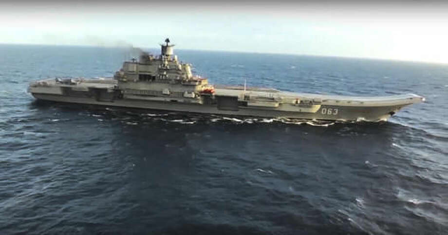 In this photo made from the footage taken from Russian Defense Ministry official web site on Tuesday, Nov. 15, 2016, the Admiral Kuznetsov aircraft carrier is on a mission in the eastern Mediterranean Sea. The Russian military on Tuesday launched a series of strikes on militant targets in Syria involving carrier-borne fighters, marking the Admiral Kuznetsov's combat debut. (Russian Defense Ministry Press Service/ Photo via AP) Photo: HOGP