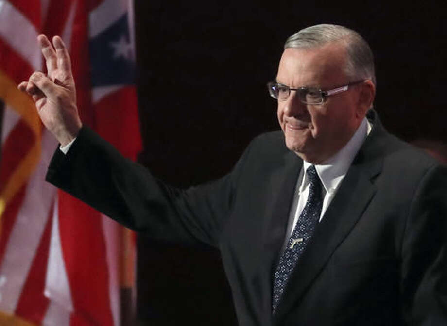 FILE - In this July 21, 2016, file photo, Sheriff Joe Arpaio of Arizona walks on the stage to speak during the final day of the Republican National Convention in Cleveland. The outgoing sheriff of metro Phoenix said he was saddened by his defeat after 24 years in office, but expressed no regrets about launching dozens of immigration patrols that made him a national political figure but ultimately led to downfall and a criminal case against him. Sheriff Joe Arpaio said Friday, Nov. 11, 2016, that he has been humbled by calls from supporters who bemoaned his loss Tuesday to Democrat Paul Penzone. (AP Photo/Paul Sancya, File) Photo: Paul Sancya