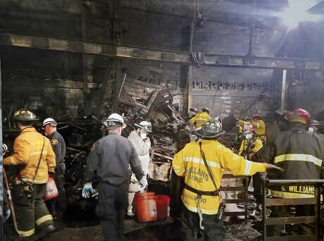 A photo released by the Oakland Fire Department, shows an interior view of the fire destruction as recovery efforts continue following the Ghost Ship fire that has so far claimed 36 lives in Oakland, Calif., on Monday, December 5, 2016.