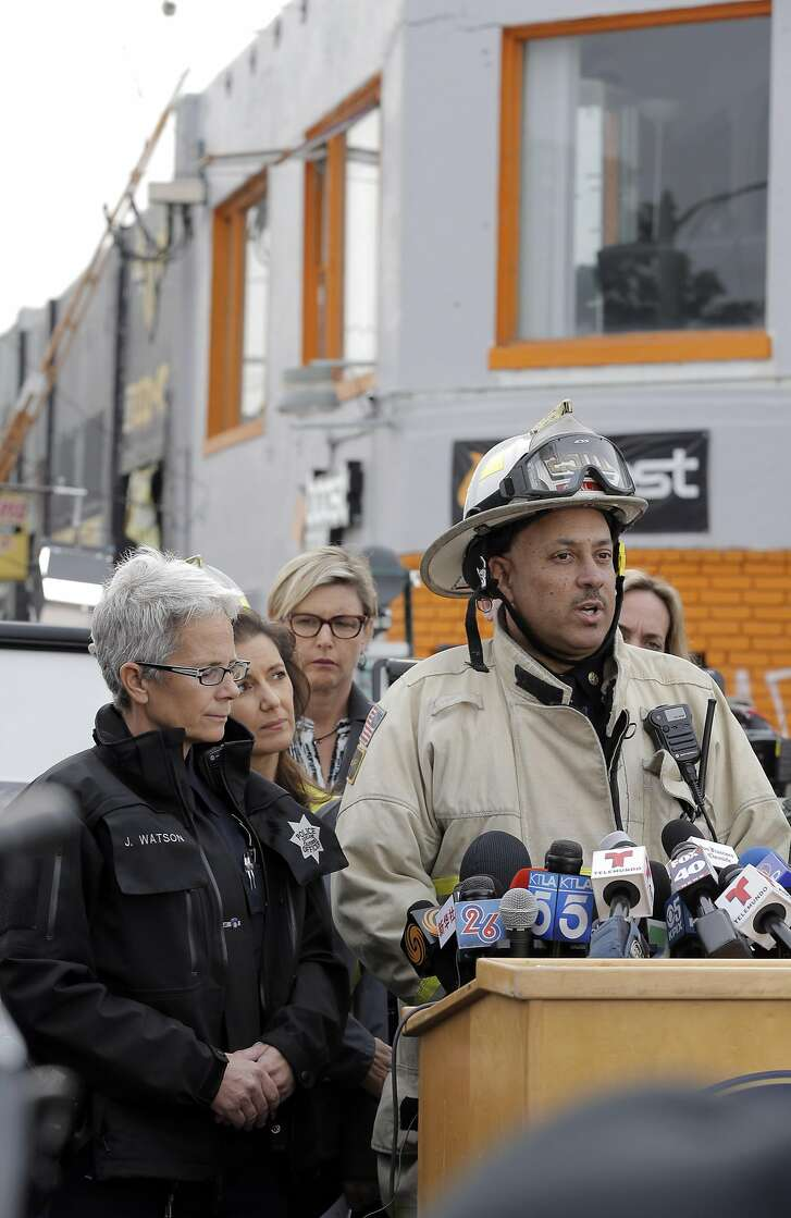 Deputy Fire Chief Darin White talks to the press as recovery efforts continue following the Ghost Ship fire that has so far claimed 36 lives in Oakland, Calif., on Monday, December 5, 2016.