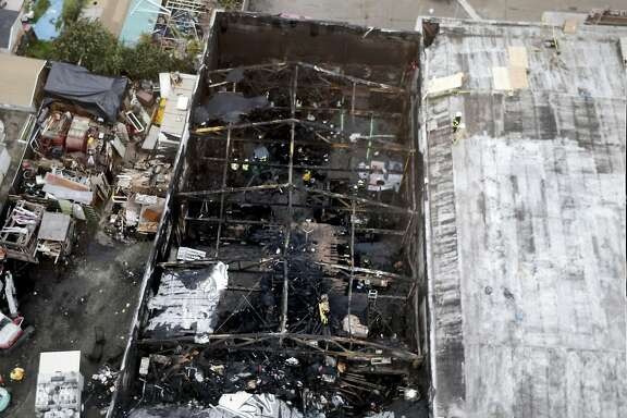 A photo released by the Oakland Fire Department, shows an aerial view of the fire destruction as recovery efforts continue following the Ghost Ship fire that has so far claimed 36 lives in Oakland, Calif., on Monday, December 5, 2016.