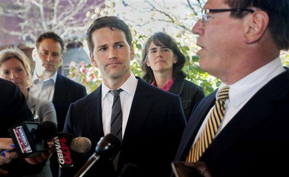 Former U.S. Rep. Aaron Schock, center, and members of his family listen as attorney Jeff Lang, right, speaks during a press conference Thursday, Nov. 10, 2016, outside Peoria Heights Village Hall in Peoria Heights, Ill. Schock's defense team said Thursday that the former congressman, who resigned amid scrutiny of lavish spending, expects to be indicted by a federal grand jury. (Matt Dayhoff/Journal Star via AP) Photo: Matt Dayhoff
