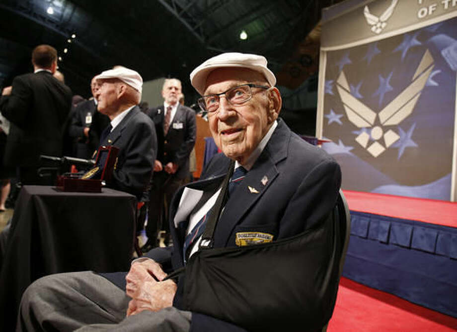 "FILE - In this April 18, 2015, file photo, two members of the Doolittle Tokyo Raiders, retired Lt. Col. Richard ""Dick"" Cole, seated foreground, and retired Staff Sgt. David Thatcher, seated background left, pose for photos after the presentation of a Congressional Gold Medal honoring the Doolittle Tokyo Raiders at the National Museum of the U.S. Air Force at Wright-Patterson Air Force Base in Dayton, Ohio. The National Museum of the U.S. Air Force plans to mark the 75th anniversary of the Doolittle Tokyo Raiders attack on Japan on April 17 and 18, 2017, and Cole, the only one of the 80 airmen still alive, expects to attend and help pay tribute to Thatcher, who died June 22, 2016, in Montana. (AP Photo/Gary Landers, File) Photo: Gary Landers"