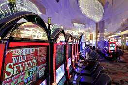 """Slot machines in the casino are seen during a preview tour of the MGM National Harbor, Friday, Dec. 2, 2016 in Oxon Hill, Md. The $1.4 billion National Harbor casino and resort just outside the nation's capital, advertises a gambling floor """"bigger than the White House,"""" is scheduled to open December 8th. (AP Photo/Alex Brandon)"""